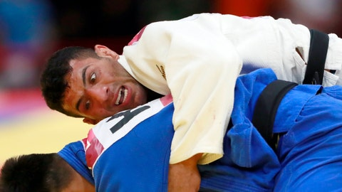 <p>               FILE - In this Thursday, Aug. 30, 2018 file photo, Saeid Mollaei of Iran, top, competes against Didar Khamza of Kazakhstan during their men's - 81kg final judo match at the18th Asian Games in Jakarta, Indonesia. Judo world champion Iran has been banned from international judo competitions for refusing to let its athletes fight Israeli opponents. The International Judo Federation has imposed an indefinite ban on Iran's team until it promises to end a long-running boycott of Israel. (AP Photo/Tatan Syuflana, File)             </p>