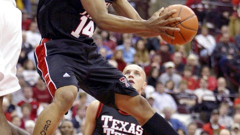 <p>               FILE - In this Jan 4, 2004, file photo, Texas Tech's Andre Emmett (14) tries to shoot around Ohio State's Terence Dials during the first half of an NCAA basketball game at Value City Arena in Columbus, Ohio. WFAA-TV reports investigators say Keith Johnson and a second suspect allegedly shot former NBA and Texas Tech standout Emmett during a Sept. 23, 2019, robbery attempt. (AP Photo/Ron Schwane, File)             </p>
