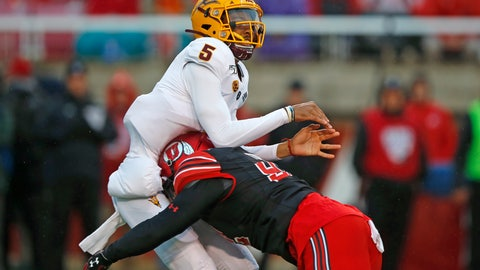 <p>               Arizona State quarterback Jayden Daniels (5) takes a hit from Utah defensive end Maxs Tupai (92) during the first half of an NCAA college football game Saturday, Oct. 19, 2019, in Salt Lake City. (AP Photo/Rick Bowmer)             </p>