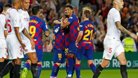 <p>               Barcelona's Lionel Messi, center, celebrates with teammates after scoring his side's fourth goal during Spanish La Liga soccer match between Barcelona and Sevilla at the Camp Nou stadium in Barcelona, Sunday, Oct. 6, 2019. Messi scored once in Barcelona's 4-0 victory. (AP Photo/Joan Monfort)             </p>