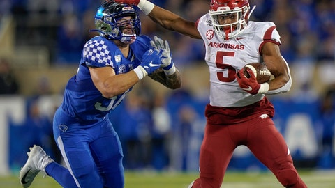 <p>               Arkansas running back Rakeem Boyd (5) runs with the ball as he is tackled by Kentucky linebacker Kash Daniel during the first half of an NCAA college football game Saturday, Oct. 12, 2019, in Lexington, Ky. (AP Photo/Bryan Woolston)             </p>
