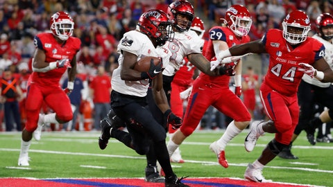 <p>               UNLV running back Charles Williams tries to get around Fresno State defensive lineman Leevel Tatum III, right, during the first half of an NCAA college football game in Fresno, Calif., Friday, Oct. 18, 2019. (AP Photo/Gary Kazanjian)             </p>