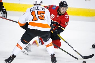 Frolik scores in his 800th NHL game, Flames beat Flyers 3-1