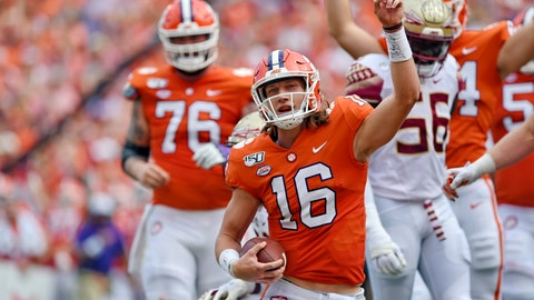 <p>               Clemson quarterback Trevor Lawrence (16) reacts after scoring a touchdown during the first half of an NCAA college football game against Florida State, Saturday, Oct. 12, 2019, in Clemson, S.C. (AP Photo/Richard Shiro)             </p>