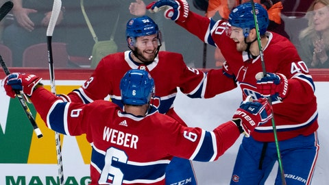<p>               Montreal Canadiens' Victor Mete celebrates his goal against the Minnesota Wild with teammates Shea Weber, left, and Joel Armia, right, during first-period NHL hockey game action in Montreal, Thursday, Oct. 17, 2019. (Paul Chiasson/The Canadian Press via AP)             </p>