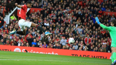 <p>               Manchester United's Marcus Rashford scores his side's opening goal during the English Premier League soccer match between Manchester United and Liverpool at the Old Trafford stadium in Manchester, England, Sunday, Oct. 20, 2019. (AP Photo/Jon Super)             </p>