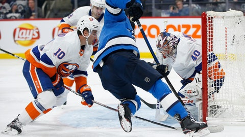 <p>               New York Islanders goaltender Semyon Varlamov (40) saves a shot from Winnipeg Jets' Andrew Copp (9) as he attempts to jam the puck in as Islanders' Derick Brassard (10) defends during the second period of an NHL hockey game Thursday, Oct. 17, 2019, in Winnipeg, Manitoba. (John Woods/The Canadian Press via AP)             </p>
