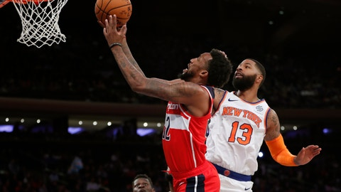 <p>               Washington Wizards guard Jordan McRae. left, goes up for a layup with New York Knicks forward Marcus Morris (13) defending during the first half of a preseason NBA basketball game in New York, Friday, Oct. 11, 2019. (AP Photo/Kathy Willens)             </p>