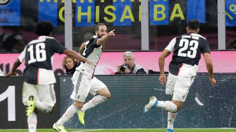<p>               Juventus' Gonzalo Higuain, centre, celebrates after scoring his side's second goal during a Serie A soccer match between Inter Milan and Juventus, at the San Siro stadium in Milan, Italy, Sunday, Oct. 6, 2019. (AP Photo/Luca Bruno)             </p>