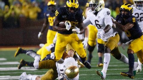 <p>               Michigan running back Hassan Haskins (25) runs over Notre Dame safety Alohi Gilman (11) during a 20-yard gain in the first half of an NCAA college football game in Ann Arbor, Mich., Saturday, Oct. 26, 2019. (AP Photo/Paul Sancya)             </p>