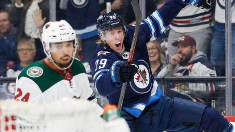 <p>               Winnipeg Jets' Patrik Laine (29) celebrates his goal as Minnesota Wild's Matt Dumba (24) skates by during the second period of an NHL hockey game Thursday, Oct. 10, 2019, in Winnipeg, Manitoba. (John Woods/The Canadian Press via AP)             </p>