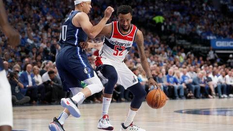 <p>               Washington Wizards' Jordan McRae (52) drives to the basket as Dallas Mavericks' Seth Curry defends during the second quarter of an NBA basketball game in Dallas, Wednesday, Oct. 23, 2019. (AP Photo/Tony Gutierrez)             </p>