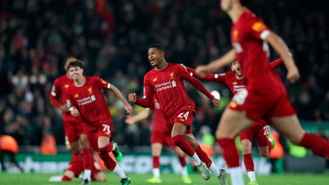 <p>               Liverpool players celebrate at the end of the English League Cup soccer match between Liverpool and Arsenal at Anfield stadium in Liverpool, England, Wednesday, Oct. 30, 2019. (AP Photo/Jon Super)             </p>