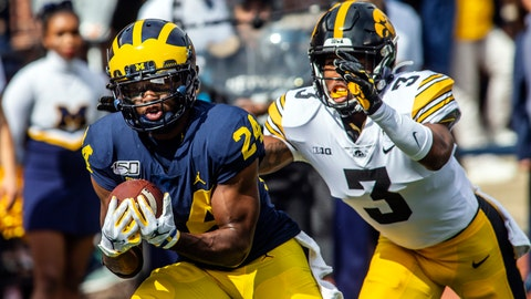 <p>               Michigan defensive back Lavert Hill (24) intercepts a pass intended for Iowa wide receiver Tyrone Tracy, Jr. (3) in the second quarter of an NCAA college football game in Ann Arbor, Mich., Saturday, Oct. 5, 2019. (AP Photo/Tony Ding)             </p>