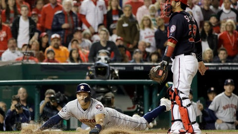 <p>               Houston Astros' Carlos Correa scores past Washington Nationals catcher Kurt Suzuki on a single by Josh Reddick during the second inning of Game 3 of the baseball World Series Friday, Oct. 25, 2019, in Washington. (AP Photo/Jeff Roberson)             </p>
