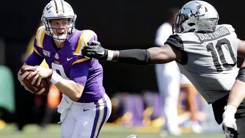 <p>               LSU quarterback Joe Burrow, left, scrambles away from Vanderbilt defensive lineman Dayo Odeyingbo (10) in the first half of an NCAA college football game Saturday, Sept. 21, 2019, in Nashville, Tenn. (AP Photo/Mark Humphrey)             </p>