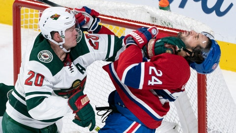 <p>               Montreal Canadiens' Phillip Danault is taken out from in front of the Wild's net by Minnesota Wild defenseman Ryan Suter during second-period NHL hockey game action in Montreal, Thursday, Oct. 17, 2019. (Paul Chiasson/The Canadian Press via AP)             </p>