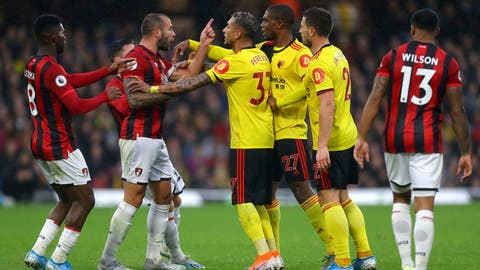 <p>               Bournemouth's Steve Cook, left, and Watford's Christian Kabasele, centre right, exchange words during the English Premier League soccer match between Watford and Bournemouth at the Vicarage Road Stadium, Watford, England. Saturday, Oct. 26 2019. (Aaron ChownPA via AP)             </p>