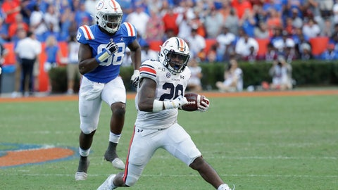 <p>               Auburn running back JaTarvious Whitlow (28) gets past Florida defensive lineman Luke Ancrum (98) for yardage during the second half of an NCAA college football game, Saturday, Oct. 5, 2019, in Gainesville, Fla. (AP Photo/John Raoux)             </p>