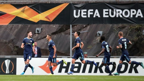 <p>               Slovan Bratislava's Andraz Sporar, left, celebrates with teammates after scoring his side's opening goal during the Europa League group K soccer match between Braga and Slovan Bratislava at the Braga stadium in Braga, Portugal, Thursday, Oct. 3, 2019. (AP Photo/Luis Vieira)             </p>