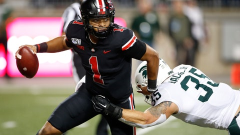 <p>               Ohio State quarterback Justin Fields, left, escapes the grasp of Michigan State linebacker Joe Bachie during the first half of an NCAA college football game Saturday, Oct. 5, 2019, in Columbus, Ohio. (AP Photo/Jay LaPrete)             </p>