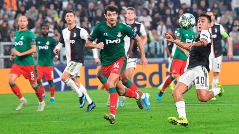 <p>               Juventus' Paulo Dybala, right, and Lokomotiv Moscow's Vedran Corluka in action during the UEFA Champions League group D soccer match at the Allianz Stadium in Turin, Italy, Tuesday, Oct. 22, 2019. (Alessandro Di Marco/ANSA via AP)             </p>
