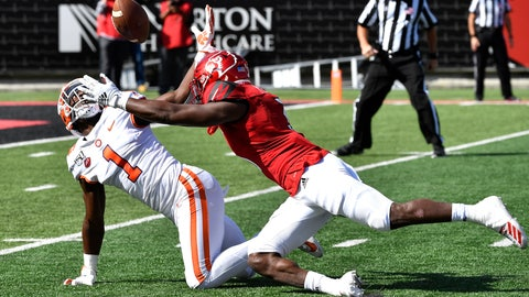 <p>               Clemson cornerback Derion Kendrick (1) and Louisville defensive back Russ Yeast (3) battle for a loose ball following a Louisville punt during the first half of an NCAA college football game in Louisville, Ky., Saturday, Oct. 19, 2019. (AP Photo/Timothy D. Easley)             </p>