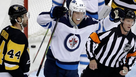 <p>               Winnipeg Jets' Patrik Laine (29) celebrates after assisting on a goal by Ville Heinola during the first period of an NHL hockey game against the Pittsburgh Penguins in Pittsburgh, Tuesday, Oct. 8, 2019. (AP Photo/Gene J. Puskar)             </p>