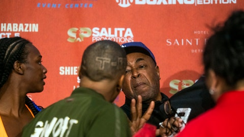 <p>               Boxer Ivana Habazin's trainer Bashir Ali, right, trash talks with members of Claressa Shields' entourage during a weigh-in Friday, Oct. 4, 2019, in Flint, Mich. Ali was later punched by a man and fell to the ground bloodied. He was sent to McLaren Hospital in Flint to be treated. Habazin and Claressa Shields are scheduled to fight Saturday for the WBO and WBC super welterweight championships. (Jake May/The Flint Journal via AP)             </p>