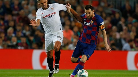 <p>               Barcelona's Lionel Messi, right, vies for the ball with Sevilla's Daniel Carrico during Spanish La Liga soccer match between Barcelona and Sevilla at the Camp Nou stadium in Barcelona, Sunday, Oct. 6, 2019. (AP Photo/Joan Monfort)             </p>