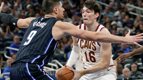 <p>               Cleveland Cavaliers forward Cedi Osman (16) looks for a way around Orlando Magic's Nikola Vucevic (9) during the second half of an NBA basketball game Wednesday, Oct. 23, 2019, in Orlando, Fla. (AP Photo/John Raoux)             </p>