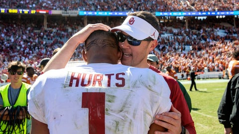 <p>               Oklahoma head coach Lincoln Riley congratulates quarterback Jalen Hurts (1) after beating Texas 34-27 in an NCAA college football game at the Cotton Bowl, Saturday, Oct. 12, 2019, in Dallas. (AP Photo/Jeffrey McWhorter)             </p>