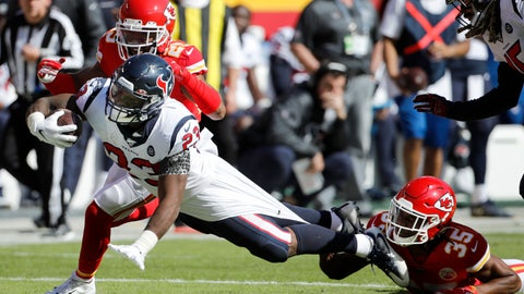 <p>               Houston Texans running back Carlos Hyde (23) is held back by Kansas City Chiefs cornerback Charvarius Ward (35) and cornerback Kendall Fuller, rear, during the second half of an NFL football game in Kansas City, Mo., Sunday, Oct. 13, 2019. (AP Photo/Colin E. Braley)             </p>