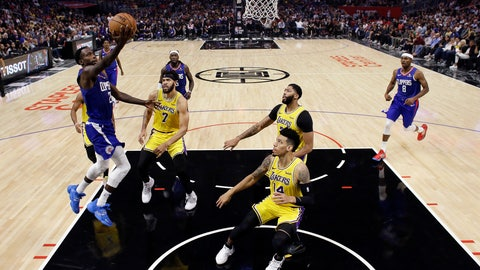 <p>               Los Angeles Clippers' Patrick Beverley, left, drives to the basket against the Los Angeles Lakers during the first half of an NBA basketball game Tuesday, Oct. 22, 2019, in Los Angeles. (AP Photo/Marcio Jose Sanchez)             </p>