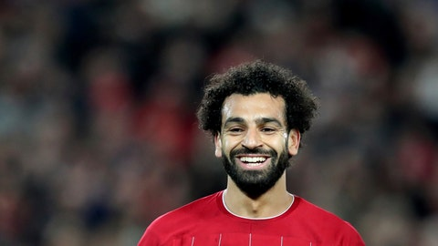 <p>               Liverpool's Mohamed Salah smiles after scoring his side's third goal during the Champions League group E soccer match between Liverpool and Red Bull Salzburg at Anfield stadium in Liverpool, England, Wednesday, Oct. 2, 2019. (AP Photo/Jon Super)             </p>