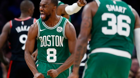 <p>               Boston Celtics' Kemba Walker (8) reacts after sinking a 3-pointer during the second half of the team's NBA basketball game against the Toronto Raptors in Boston, Friday, Oct. 25, 2019. (AP Photo/Michael Dwyer)             </p>