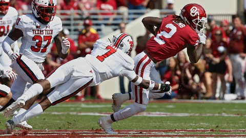 <p>               Oklahoma wide receiver CeeDee Lamb (2) avoids a tackle by Texas Tech defensive back Adrian Frye (7) in the second quarter of an NCAA college football game in Norman, Okla., Saturday, Sept. 28, 2019. (AP Photo/Sue Ogrocki)             </p>