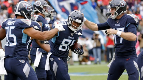 <p>               Tennessee Titans tight end Jonnu Smith (81) is congratulated by tight end MyCole Pruitt (85) and quarterback Ryan Tannehill (17) after Smith scored a touchdown against the Tampa Bay Buccaneers in the first half of an NFL football game Sunday, Oct. 27, 2019, in Nashville, Tenn. (AP Photo/James Kenney)             </p>