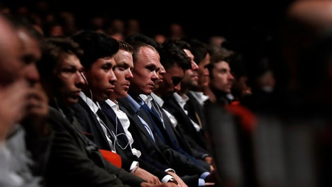 <p>               Britain's Chris Froome, center, attends the presentation of the Tour de France 2020 cycling race, in Paris, Tuesday Oct. 15, 2019. The 107th edition of the race starts on June 27 2019 to end on the Champs-Elysees avenue on July 19. (AP Photo/Thibault Camus)             </p>