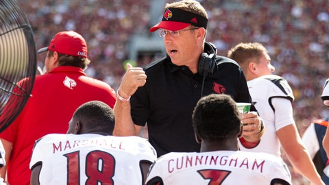 <p>               Louisville head coach Scott Satterfield talks to Louisville quarterback Malik Cunningham (3) and wide receiver Justin Marshall (18) in the first half of an NCAA college football game against Florida State, in Tallahassee, Fla., Saturday, Sept. 21, 2019.             </p>
