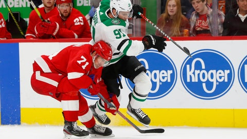 <p>               Dallas Stars center Tyler Seguin (91) and Detroit Red Wings center Dylan Larkin (71) chase the puck in the first period of an NHL hockey game Sunday, Oct. 6, 2019, in Detroit. (AP Photo/Paul Sancya)             </p>