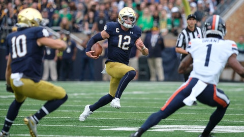 <p>               Notre Dame quarterback Ian Book (12) runs with the ball in front of Virginia cornerback Nick Grant (1) in the first half of an NCAA college football game in South Bend, Ind., Saturday, Sept. 28, 2019. (AP Photo/AJ Mast)             </p>