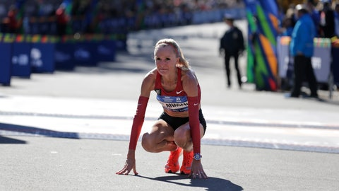 """<p>               FILE - In this Nov. 4, 2018 file photo Shalane Flanagan of the United States reacts after crossing the finish line third in the women's division of the New York City Marathon in New York. Flanagan says she is retiring from competitive running to become a coach. She made the announcement Monday, Oct. 21, 2019 saying she has only one regret: """"I regret I can't do it all over again."""" (AP Photo/Seth Wenig, file)             </p>"""