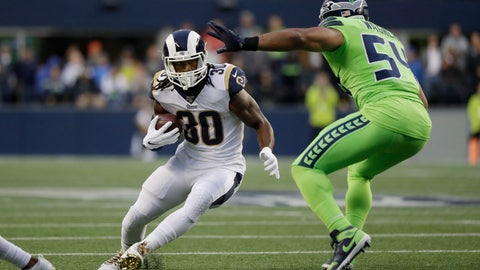 <p>               Los Angeles Rams running back Todd Gurley, left, squares off against Seattle Seahawks middle linebacker Bobby Wagner during the first half of an NFL football game Thursday, Oct. 3, 2019, in Seattle. (AP Photo/Elaine Thompson)             </p>
