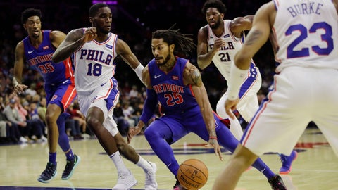 <p>               Detroit Pistons' Derrick Rose (25) drives as Philadelphia 76ers' Shake Milton (18), Joel Embiid (21) and Trey Burke (23) defend and 76ers' Christian Wood (35) watches during the first half of an NBA preseason basketball game Tuesday, Oct. 15, 2019, in Philadelphia. (AP Photo/Matt Rourke)             </p>