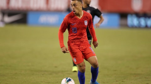 <p>               FILE - In this Sept. 6, 2019, file photo, United States defender Sergino Dest looks to pass the ball during an international friendly soccer match against the Mexico, in East Rutherford, N.J. Dest was left off the U.S. roster for CONCACAF Nations League matches against Cuba and Canada, a decision that keeps open his option to switch allegiance from the Americans to the Netherlands. (AP Photo/Steve Luciano, FIle)             </p>