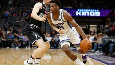 <p>               Sacramento Kings guard Buddy Hield, right, drives against Melbourne United guard Chris Goulding during the second half of an NBA exhibition basketball game in Sacramento, Calif., Wednesday, Oct. 16, 2019. The Kings won 124-110. (AP Photo/Rich Pedroncelli)             </p>