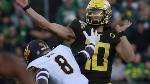 <p>               Oregon quarterback Justin Herbert, right, passes under pressure from California's Kuony Deng during the second quarter of an NCAA college football game Saturday, Oct.. 5, 2019, in Eugene, Ore. (AP Photo/Chris Pietsch)             </p>