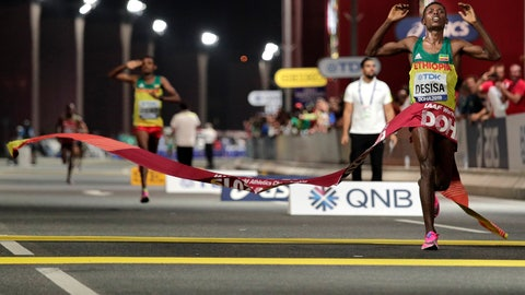 <p>               FILE - In this Oct. 6, 2019, file photo, Lelisa Desisa, of Ethiopia, wins the men's marathon at the World Athletics Championships in Doha, Qatar. The IOC is seeking to relocate next summer's Olympic marathon from steamy Tokyo to the cooler northern city of Sapporo after seeing competitors collapse in extreme heat at the world championships in Qatar.  (AP Photo/Nariman El-Mofty, File)             </p>