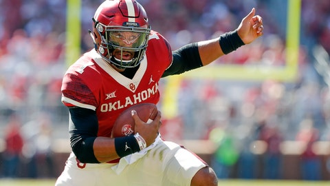 <p>               Oklahoma quarterback Jalen Hurts (1) runs against West Virginia during the first half of an NCAA college football game in Norman, Okla., Saturday, Oct. 19, 2019. (AP Photo/Alonzo Adams)             </p>